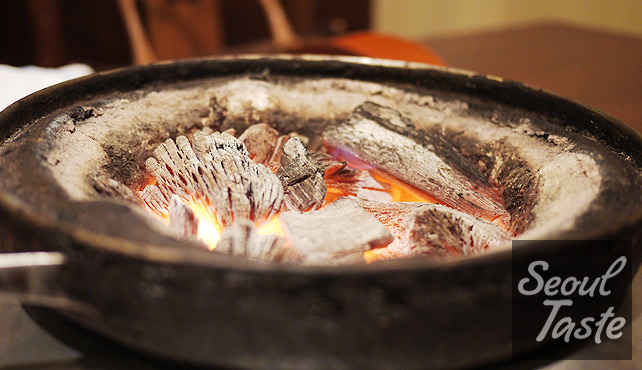 Bucket of hot Korean charcoal = perfect for grilling kalbi